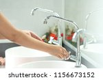 the woman's hand is going to... | Shutterstock . vector #1156673152