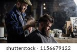 barber with clipper trimming... | Shutterstock . vector #1156679122