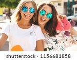 two young stylish smiling... | Shutterstock . vector #1156681858