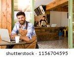 cafe owner in cafe | Shutterstock . vector #1156704595