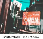 a  shop has a sign that is open ... | Shutterstock . vector #1156754362