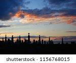 sunset over cemetery gaspesie... | Shutterstock . vector #1156768015