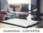 judge gavel with justice... | Shutterstock . vector #1156769518