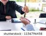 real estate agent handing over... | Shutterstock . vector #1156796458