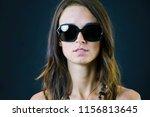 cute stylish brunette girl on a ... | Shutterstock . vector #1156813645