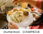 woman cooking in the kitchen.  | Shutterstock . vector #1156898218