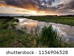 summer sunset over canal in... | Shutterstock . vector #1156906528
