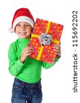 Smiling little boy in Santa's hat with red gift box, isolated on white - stock photo