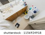 messy little half bathroom with ...   Shutterstock . vector #1156924918
