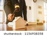 Small photo of lawyer mediating in a property dispute .Auctioneer knocking down a property sale.Real estate sale auction concep.