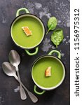 green cream of spinach soup on... | Shutterstock . vector #1156975312