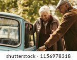 caring gentleman wearing warm... | Shutterstock . vector #1156978318