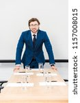 smiling young businessman... | Shutterstock . vector #1157008015