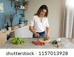 woman preparing salad in the... | Shutterstock . vector #1157013928