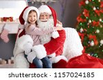 little girl sitting on... | Shutterstock . vector #1157024185