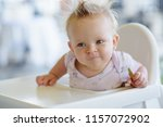 cute baby eating biscuit on the ... | Shutterstock . vector #1157072902