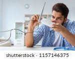 frustrated young man due to... | Shutterstock . vector #1157146375