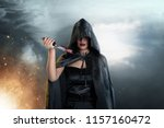 dark witch with black hooded... | Shutterstock . vector #1157160472