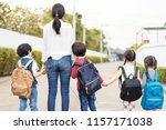 mother and four kids holding... | Shutterstock . vector #1157171038