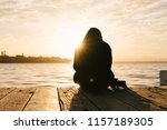 silhouette of a girl and camera ... | Shutterstock . vector #1157189305