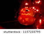 two orange glowing carved... | Shutterstock . vector #1157233795