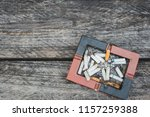 many cigarette stubs and ash in ...   Shutterstock . vector #1157259388