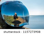 a man in the reflection of a... | Shutterstock . vector #1157273908