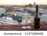 champagne at the rooftop at... | Shutterstock . vector #1157308408