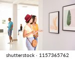 Stock photo young women at exhibition in art gallery 1157365762