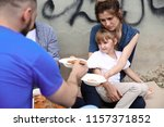 Poor People Receiving Food From ...