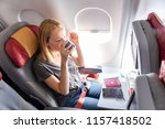 woman on commercial passengers... | Shutterstock . vector #1157418502