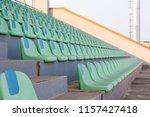 broken stadium chairs | Shutterstock . vector #1157427418