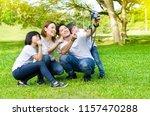 asian family taking selfie in... | Shutterstock . vector #1157470288