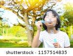 outdoor portrait of asian girl... | Shutterstock . vector #1157514835