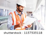 young indian engineer holding... | Shutterstock . vector #1157535118