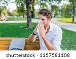 man with handkerchief sneezes.... | Shutterstock . vector #1157581108