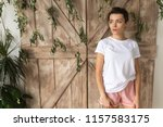 beautiful woman in a white t... | Shutterstock . vector #1157583175