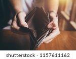 empty money in wallet   poverty ... | Shutterstock . vector #1157611162