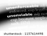 Small photo of unenviable word in a dictionary. unenviable concept.