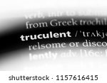 Small photo of truculent word in a dictionary. truculent concept.