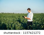 young agronomist holds tablet... | Shutterstock . vector #1157621272
