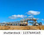 Small photo of gravel sorting conveyor machine under an open sky