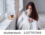 cold and flu. sick woman caught ... | Shutterstock . vector #1157707345