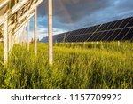 solar panels on a green field.... | Shutterstock . vector #1157709922