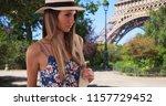 pretty lady in floral romper... | Shutterstock . vector #1157729452