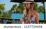 pretty lady in floral romper... | Shutterstock . vector #1157729458