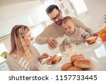 family of three having... | Shutterstock . vector #1157733445