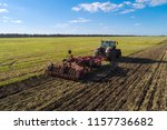 agricultural tractor plowing... | Shutterstock . vector #1157736682