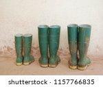 three dirty green wellies... | Shutterstock . vector #1157766835