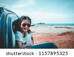 happy asian girl in sunglasses... | Shutterstock . vector #1157895325